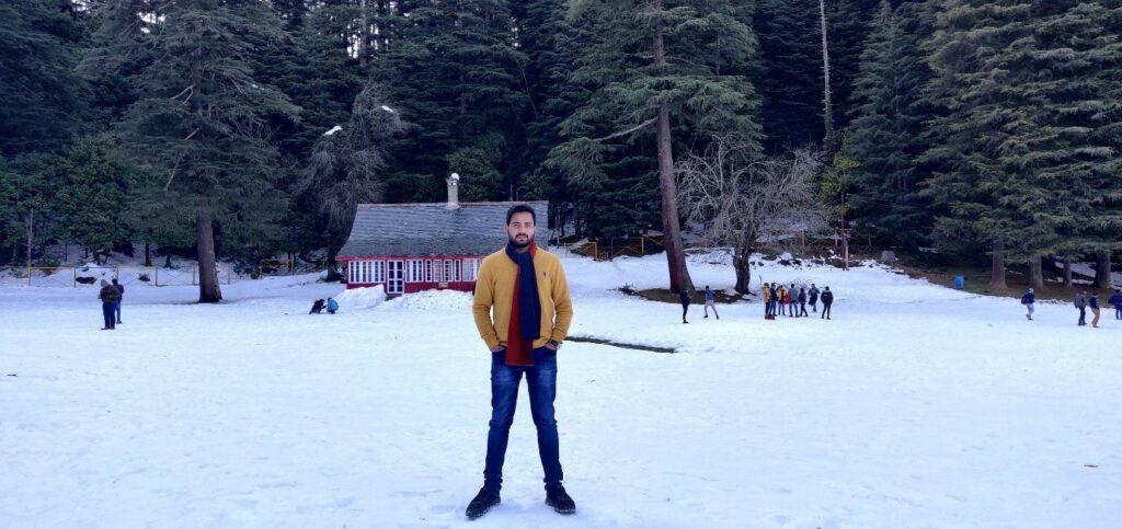 A photo of JD in a snowbound landscape in Khajjiar in Himachal Pradesh, India.