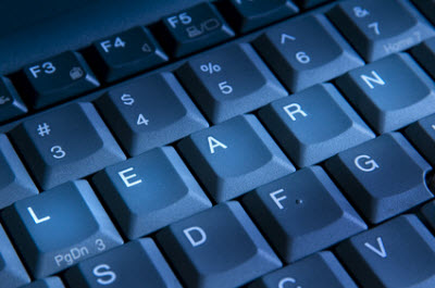 Artistic image of keyboard doctored to say e-learning