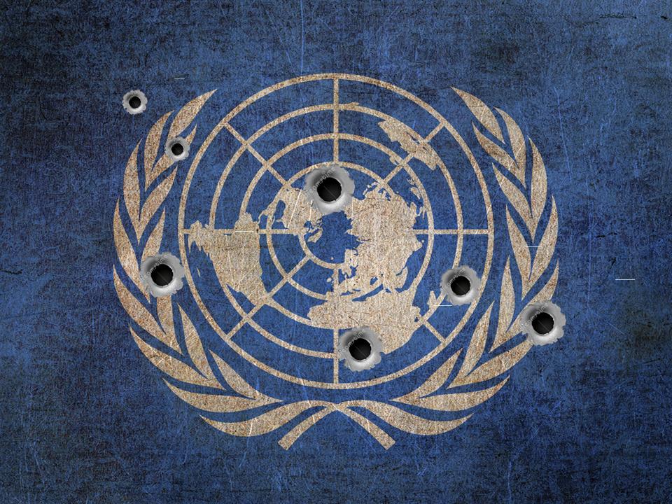 UN flag bullet holes